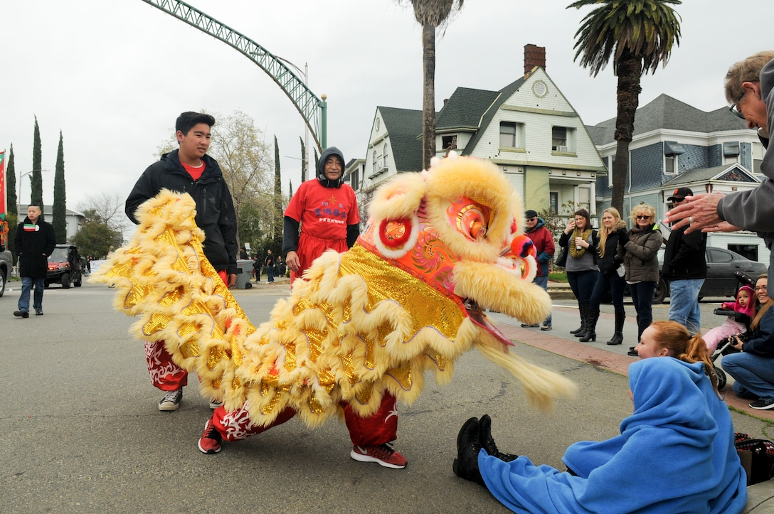 San Francisco Lion Dancers interact with Bok Kai Festival patrons in Marysville, California, Mar. 12, 2016. The Bok Kai Festival has been a 136-year tradition for the historic Chinatown in Marysville. The event brought multiple groups from many parts of the world to participate.