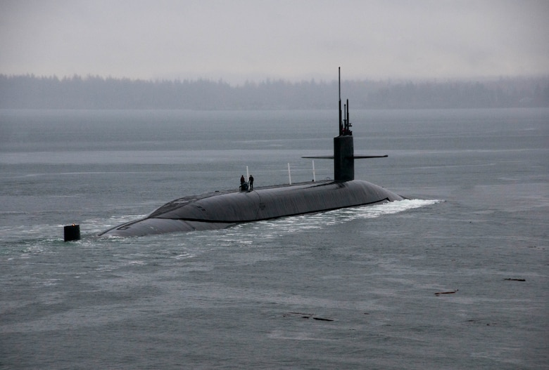 PUGET SOUND, Wash. (March 13, 2016) - The Ohio-class ballistic-missile submarine USS Kentucky (SSBN 737) departs Naval Base Kitsap-Bangor for the boat's first strategic deterrent patrol since 2011. The boat recently completed a 40-month Engineered Refueling Overhaul, which will extend the life of the submarine for another 20 years. (U.S. Navy photo by Mass Communication Specialist 2nd Class Amanda R. Gray/Released)
