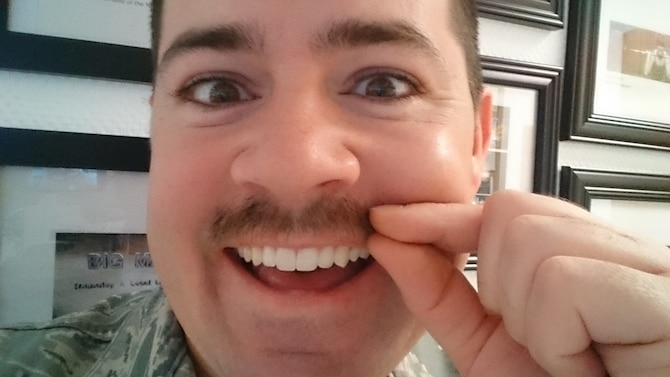 U.S. Air Force Staff Sgt. Christopher Ruano, a 52nd Fighter Wing public affairs photojournalist, takes a selfie with his mustache, Gregory, in honor of Mustache March, March 14, 2016. Mustache March is an Air Force tradition that started during the Vietnam War and is still practiced today. (U.S. Air Force selfie by Staff Sgt. Christopher Ruano/Released)