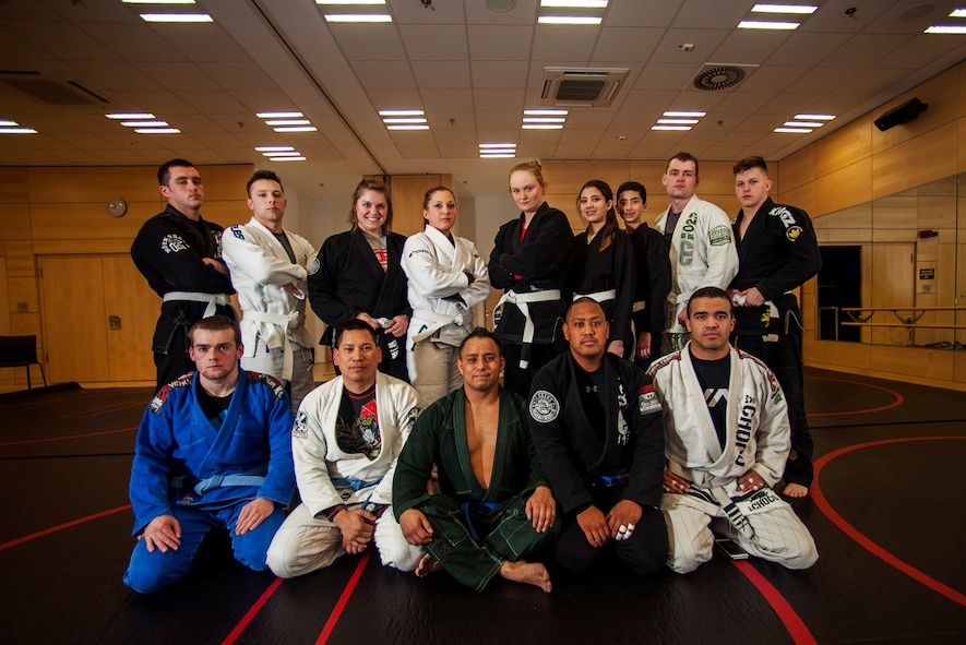 The Spangdahlem Brazilian Jiu Jitsu class poses for a group photo in the Eifel Powerhaus at Spangdahlem Air Base, Germany, March 8, 2016. The class takes place on Mondays and Tuesdays from 6:30 to 7 p.m., and is free and open to all base community members. (U.S. Air Force photo by Airman 1st Class Timothy Kim/Released)