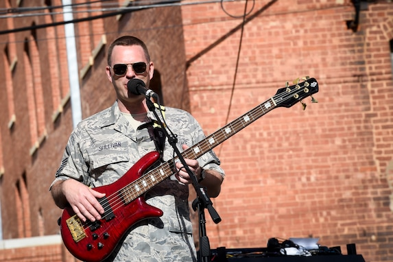 "Master Sgt. Eric Sullivan, United States Air Force Band's Celtic Aire vocalist and bassist, sings ""Galway Girl"" during a performance at the Wichita Falls Irish Street Festival in Wichita Falls, Texas, March 12, 2016. The band is the premier Celtic and folk ensemble of the U.S. Air Force Band. (U.S. Air Force photo by Senior Airman Ryan J. Sonnier/RELEASED)"