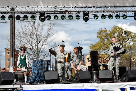 Erin Hixson (left), Tir Conaill Academy of Irish Dance student, dances on stage with the United States Air Force Band's Celtic Aire during a performance at the Wichita Falls Irish Street Festival in Wichita Falls, Texas, March 12, 2016. The band is the premier Celtic and folk ensemble of the U.S. Air Force Band. (U.S. Air Force photo by Senior Airman Ryan J. Sonnier/RELEASED)