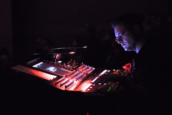 Senior Master Sgt. Adam Dempsey, United States Air Force Band's Celtic Aire sound engineer, operates a soundboard during a performance at the Cultural Activities Center in Temple, Texas, March 8, 2016. This show was part of a North Texas tour from March 4 – 12. (U.S. Air Force photo by Senior Airman Ryan J. Sonnier/RELEASED)