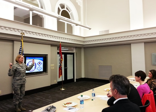 Col. Bobbi Doorenbos, 188th Wing commander, speaks to area company human resource professionals at the Fort Smith Regional Chamber of Commerce March 10. The objective of the meeting was to educate local companies on a partnership initiative between the 188th and the Chamber of Commerce. The strategy focuses on linking drill-status Guardsmen with full-time employment opportunities in the River Valley. The meeting educated local employers on specific training and education 188th members receive and how those specialties can benefit the local civilian workforce. (U.S. Air National Guard photo by Maj. Heath Allen/Released)