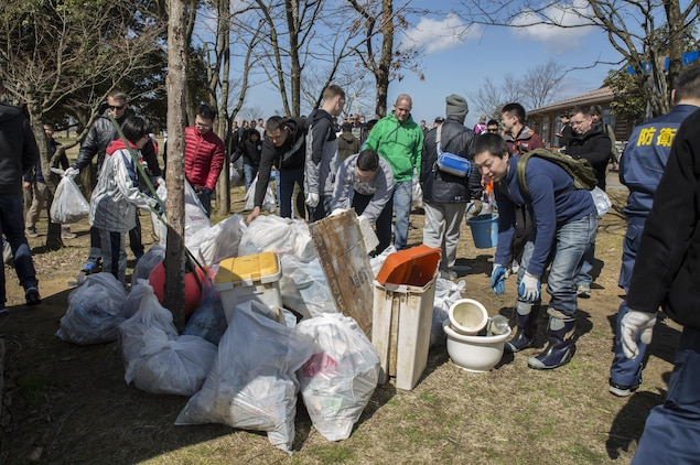Members of Marine Fighter Attack Squadron (VMFA) 314, forward based at Marine Corps Air Station Iwakuni, Japan; Marine Aviation Logistics Squadron 12; Marine Aircraft Group 12 and Japan Air Self-Defense Force pile all the trash gathered during Operation Kibagata at Kibagata Park, Komatsu, Japan, March 12, 2016. Operation Kibagata brought participants of the Komatsu Aviation Training Relocation exercise at Komatsu Air Base together to clean the local community. Community relations events not only lend a hand to the local community, they are an important aspect of strengthening one of the world's strongest alliances in order to maintain peace and stability in the region. (U.S. Marine Corps photo by Cpl. Nicole Zurbrugg/Released)