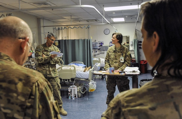 Maj. (Dr.) Valerie Sams, 455th Expeditionary Medical Group trauma czar, listens to a patient progress and treatments from Lt. Col. (Dr.) Robert Stankewitz, 455th EMDG staff physician, at Craig Joint-Theater Hospital on Bagram Air Field, Afghanistan, March 5, 2016. The trauma czar is responsible for coordinating patient care and making the final decision on treatment. (U.S. Air Force photo by Tech. Sgt. Nicholas Rau)