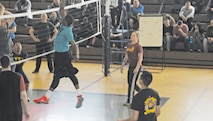 The 97th Military Police Battalion spent of day of relaxation and a spirited volleyball tournament on Friday, March 4, at King Field House, Fort Riley. Here Sgt. Demetrius James of the 287th MP Company sends the ball back across the net.