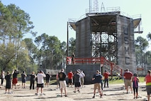 Educators with Recruiting Station Harrisburg prepare to descend on the repel tower during the Educators' Workshop, at Recruit Training Depot Parris Island, March 10, 2016. The repel tower is one of many challenges recruits must overcome before earning the title of Marine.