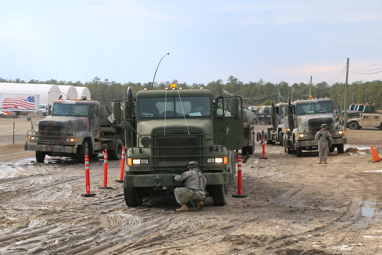Soldiers of the Army Reserve's 766th Transportation Battalion perform post convoy checks and maintenance during unit convoy operations, during WAREX 78-06-01 at Joint Base McGuire-Dix-Lakehurst, N.J., Feb. 1, 2015. The 84th Training Command's first WAREX of the year was hosted by the 78th Training Division at Joint Base McGuire-Dix-Lakehurst, N.J., and Fort Hunter Liggett, Calif.; the exercise involved more than 40 units from across the U.S. Army Reserve, U.S. Army National Guard and Canadian Armed Forces.