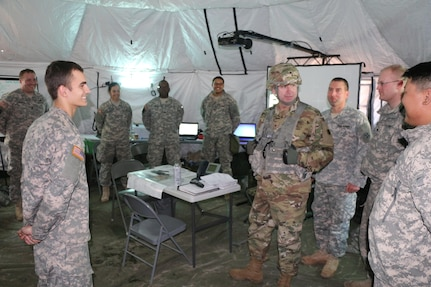 Soldiers of the Army Reserve's 766th Transportation Battalion speak with Brig. Gen. Vincent B. Barker, 310th Sustainment Command (Expeditionary) commander, on exercise operational and living conditions during a staff assisted site visit during WAREX 78-06-01 at Joint Base McGuire-Dix-Lakehurst, N.J., Jan. 31, 2015. The 84th Training Command's first WAREX of the year is hosted by the 78th Training Division at Joint Base McGuire-Dix-Lakehurst, N.J. and Fort Hunter Liggett, Calif.; the exercise involves more than 40 units from across the U.S. Army Reserve, U.S. Army National Guard and Canadian Armed Forces.
