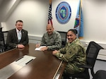 From left: Donald Liles, DLA liaison to U.S. Africa Command; Air Force Maj. Gen. James C. Vechery, AFRICOM director for logistics; and Army Col. Elizabeth Delbridge-Keough, commander of DLA Europe and Africa sign a three-year agreement to extend DLA support to AFRICOM in Stuttgart, Germany, Feb. 18, 2016.