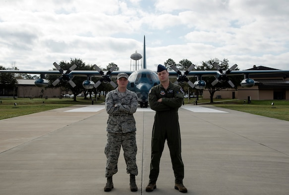 U.S. Air Force Staff Sgt. Adam Palmer, 23d Operations Support Squadron air traffic controller, left, poses for a photo with his younger brother Senior Airman Philip Palmer, 71st Rescue Squadron loadmaster, March 14, 2016, at Moody Air Force Base, Ga. The brothers have spent four years at Moody and were allowed the opportunity to fulfill their duties as Airmen, together. (U.S. Air Force Photo by Airman 1st Class Janiqua P. Robinson/Released)