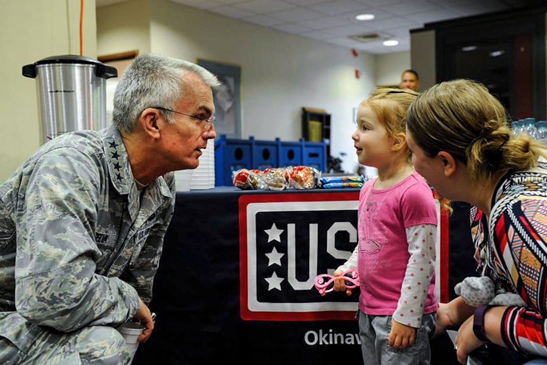 Air Force Gen. Paul J. Selva, vice chairman of the Joint Chiefs of Staff, greets Olivia, 3, and her mother, Sara Jackson, during the USO spring tour on Kadena Air Base in Okinawa, Japan, March 14, 2016. Selva held an event for Team Kadena and celebrity visitors on the base. Air Force photo by Senior Airman Peter Reft