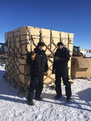 Tech. Sgts. Adam Myers (left) and Justin Carkner stand in front of the first pallet they built at the South Pole Station on Jan. 23, 2016. The team was tasked to build and inspect pallets of excess and obsolete materials currently stored at the South Pole Station as part of the newly established South Pole Retrograde Initiative. Myers is a firefighter with the 109th Fire Department, and Carkner is assigned to the 109th Logistics Readiness Squadron's Air Transportation Operations section. (Courtesy photo)