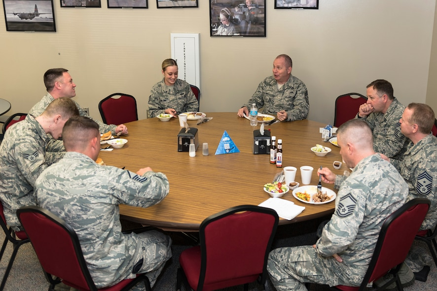 U.S. Air Force Chief Master Sgt. James W. Hotaling, top center-right, the command chief of the Air National Guard, eats lunch with the Illinois Air National Guard 182nd Airlift Wing's outstanding Airmen of the year in Peoria, Ill., March 4, 2016. Hotaling visited the wing's enlisted corps to discuss renewing the commitment to the profession of arms, the health of the force and embracing accomplishments. (U.S. Air National Guard photo by Staff Sgt. Lealan Buehrer)