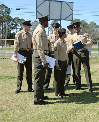 Marines from the base prepare to examine more than 140 Westover High School Marine Corps Junior Reserve Officer Training Cadets during an annual inspection at the school recently.