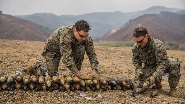U.S. Marines Gunnery Sgt. Jordan Torcello and Staff Sgt. Zachary Rubemeyer, explosive ordnance disposal technicians with the 13th Marine Expeditionary Unit, lay undetonated ordnance for a controlled detonation during Exercise Ssang Yong 16 on Suseongri live-fire range, Pohang, South Korea, March 13, 2016. Ssang Yong is a biennial combined amphibious exercise conducted by U.S. forces with the Republic of Korea Navy and Marine Corps, Australian Army and Royal New Zealand Army Forces in order to strengthen interoperability and working relationships across a wide range of military operations.