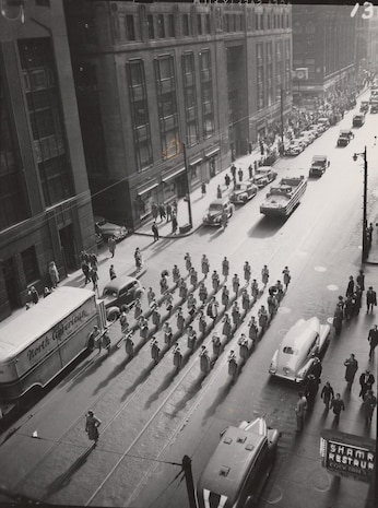 6th War Bond Exhibition, Chicago, IL, Nov 1944. Marching Band of Women Marines led this section of a troop parade, encouraging the purchase of War Bonds during World War II.