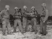 Flamethrower Instruction, c. 1944. Marines receive instruction on the function of the M2-2 flamethrower.