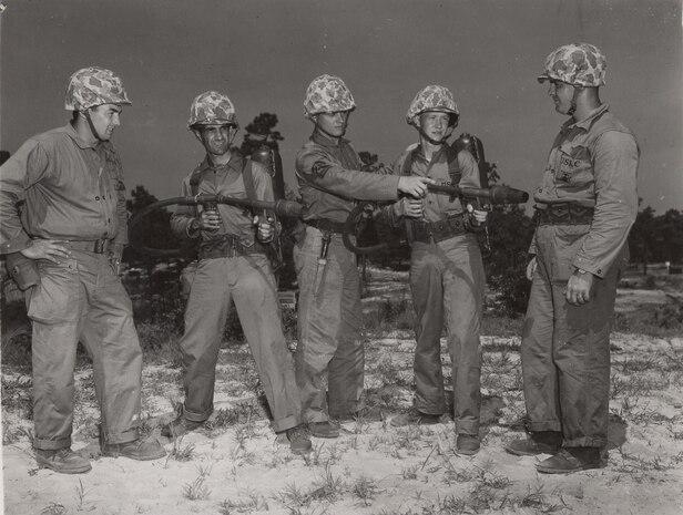Flamethrower Instruction, c. 1944. Marines receive instruction on the function of the M2-2 flamethrower.