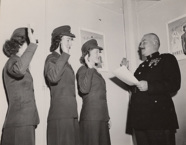 1st Marine Corps Recruiting District, Boston, MA, April 27, 1949. These Women Marines are sworn into service to begin the formation of the Women's Organized Marine Corps Reserve unit in Boston.