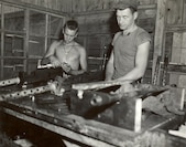 33rd Marine Aircraft Group, Okinawa, Japan, April-May 1945. Marines maintenance and prepare aircraft armament, .50 caliber machineguns, for Marine aircraft.