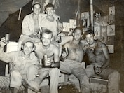 33rd Marine Aircraft Group, Okinawa, Japan, April-May 1945. Marines enjoy their down-time with a case of beer.
