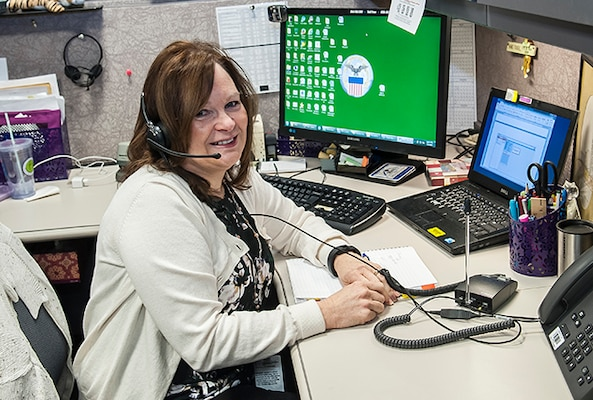 Jamie Carnevale works a customer systems issue while staffing the LTC help desk. Carnevale is part of an eight person team that works in Land and Maritime's Systems Branch.