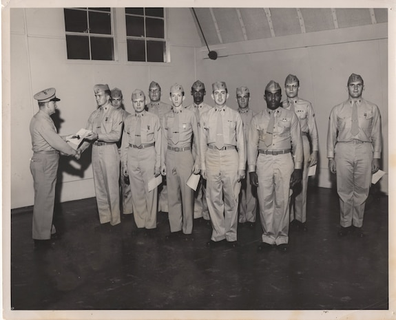 61st Special Marine Infantry Company, Lexington, KY, 1954. These Reserve Marines are recognized for their exceptional marksmanship skills by receiving their expert pistol marksmanship badges and certificates.
