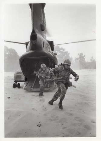 3rd Battalion, 24th Marine Regiment, 1976. These Reserve Marines rush out the ramp of a CH-46 helicopter during a helicopter-insertion exercise during Operation Bonded Item. This operation was a major NATO exercise involving several military contingents.