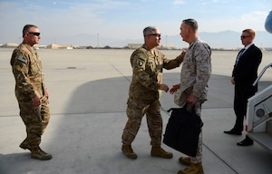 Army Gen. John F. Campbell, center left, then-commander of NATO's Resolute Support mission and U.S. forces in Afghanistan, welcomes Marine Corps Gen. Joseph F. Dunford Jr., chairman of the Joint Chiefs of Staff, to Bagram Airfield, Afghanistan, Dec. 8, 2015. DoD photo by Air Force Staff Sgt. Tony Coronado