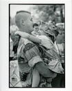 14th Marine Regiment, 1991. A father and daughter reunite at a unit homecoming celebration.