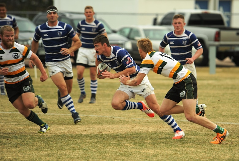 Zoomies' flanker Hunter Hancock advances the ball against Colorado State University March 12, 2016, after finding space between CSU defenders. The U.S. Air Force Academy men's rugby team defeated CSU 51-28. (U.S. Air Force photo/John Van Winkle)