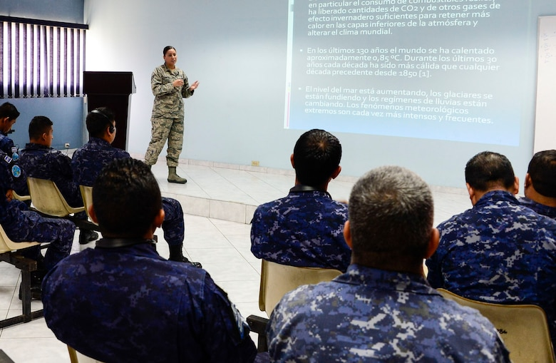 U.S. Air Force Staff Sgt. Karina Cortes, 628th Medical Operations Squadron medical technician, briefs a group of Salvadoran air force members on how weather can affect an individual's health during a medical subject matter expert exchange at Ilopango Air Base, El Salvador, March 9, 2016. 12th Air Force (Air Forces Southern) surgeon general's office, led a five-member team of medics from around the U.S. Air Force on a week-long medical subject matter expert exchange in El Salvador. (U.S. Air Force photo by Tech. Sgt. Heather R. Redman/Released)