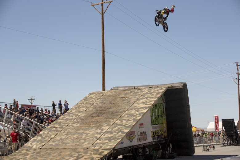 Jimmy Fitzpatrick, freestyle motocross rider, Metal Mulisha, performs stunts at the Motocross Jam Fest aboard the Combat Center March 12, 2016. The event, hosted by Marine Corps Community Services, included concession stands, motorcycle stunt performances by professional motocross riders, and live rock music from Boston-based band, Lansdowne. (Official Marine Corps photo by Lance Cpl. Levi Schultz/Released)
