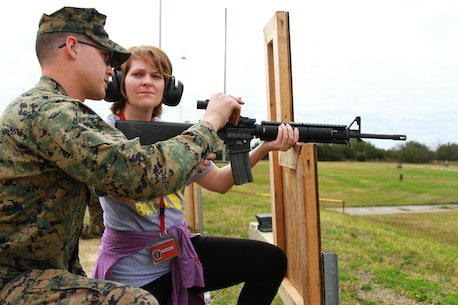 Amy Gehring, an educator at Upper Dauphin High School, receives tips on how to shoot her M-16A4 rifle during an Educators' Workshop at Marine Corps Recruit Depot Parris Island, S.C., March 9, 2016. The Marine Corps invited teachers from New York, Pennsylvania and Vermont to experience how Marines are made at the depot. The educators were given the opportunity to shoot the same weapon as recruits and were accompanied by Marine Corps marksmanship instructors. (U.S. Marine Corps photo by Cpl. Brandon Thomas/released)