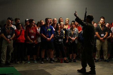 Educators from Pennsylvania, New York, and Vermont are instructed in weapon safety before participating in the Indoor Simulated Marksmanship Trainer during the Educators' Workshop on Marine Corps Recruit Depot Parris Island, S.C., March 9, 2016. The educators received an in-depth, behind-the-scenes look at Marine Corps recruit training during the three-day workshop. (U.S. Marine Corps photo by Cpl. Brandon Thomas/released)