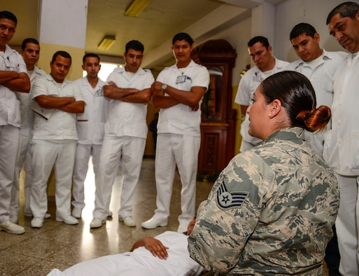 U.S. Air Force Staff Sgt. Karina Cortes, a medical technician stationed at Joint Base Charleston, S.C., briefs to medical technicians in training on litter carry techniques at Hospital Militar de El Salvador during a medical subject matter expert exchange in San Salvador, El Salvador, March 11, 2016. Earlier in the week, Carey led a team of Air Force medical professionals in a week-long exchange with Salvadoran medics at Ilopango Air Base.  After the subject matter expert exchange was completed, the team was invited to a share their expertise with members of the Hospital Militar de El Salvador.  (U.S. Air Force photo by Tech. Sgt. Heather R. Redman/Released)
