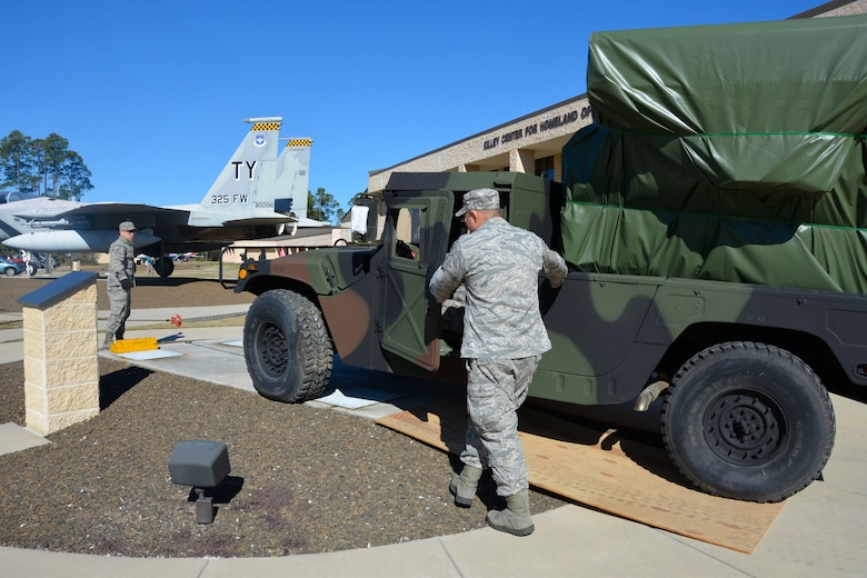 The Avenger Air -Defense System is pulled toward its final destination in front the Killey Center for Homeland Operations Feb. 18.