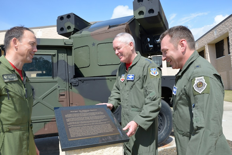 BGen. Alain Pelletier, Deputy Commander, Continental North American Aerospace Defense Region,  Lt. Gen. William Etter, Commander, Continental North American Aerospace Defense Region-1st Air Force (Air Forces Northern) and Brig. Gen. David Hicks, Vice Commander, 1st Air Forces Northern, look over the commemorative plaque of the Avenger Air -Defense System that arrived at the Killey Center for Homeland Operations Feb. 18.