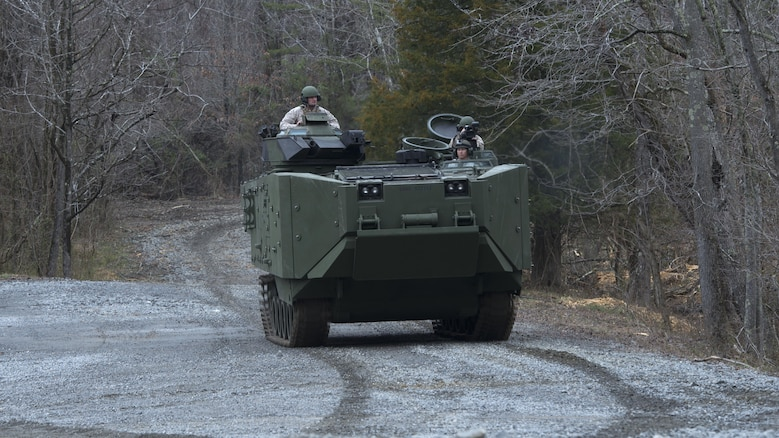 Marines give civilian media a ride in the inside the Amphibious Assault Vehicle Survivability Upgrade at Marine Corps Base Quantico, Va., March 15, 2016. The AAV SU, or amphibious assault vehicle survivability upgrade, will build upon the existing hull. The upgrades include additional armor, blast-mitigating seats and spall liners. They may also include fuel tank protection and automotive and suspension upgrades to keep both land and sea mobility regardless of the added weight.