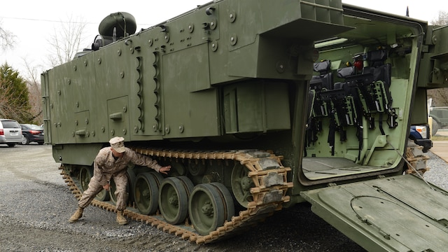 Maj. Paul Rivera, the Amphibious Assault Vehicle Survivability Upgrade Project team lead, gives a presentation at Marine Corps Base Quantico, Va., March 15, 2016. The AAV SU, or amphibious assault vehicle survivability upgrade, will build upon the existing hull. The upgrades include additional armor, blast-mitigating seats and spall liners. They may also include fuel tank protection and automotive and suspension upgrades to keep both land and sea mobility regardless of the added weight.