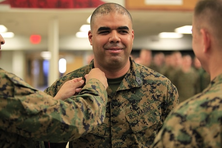 NAVAL SUPPORT FACILITY INDIAN HEAD, Md. – Lafayette, La.- Native Nester G. Antoine Jr., a Marine Military Policeman and Reaction Force Company Gunnery Sergeant, with Chemical Biological Incident Response Force (CBIRF), U.S. Marine Forces Command (MARFORCOM), is promoted (frocked) to the rank of master sergeant at Chemical Biological Incident Response Force (CBIRF), Indian Head, Md., March 1, 2016. When directed, CBIRF forward-deploys and/or responds with minimal warning to a chemical, biological, radiological, nuclear or high-yield explosive (CBRNE) threat or event in order to assist local, state, or federal agencies and the geographic combatant commanders in the conduct of CBRNE response or consequence management operations, providing capabilities for command and control; agent detection and identification; search, rescue, and decontamination; and emergency medical care for contaminated personnel. (Official USMC Photo by Sgt. Santiago G. Colon Jr./Released)
