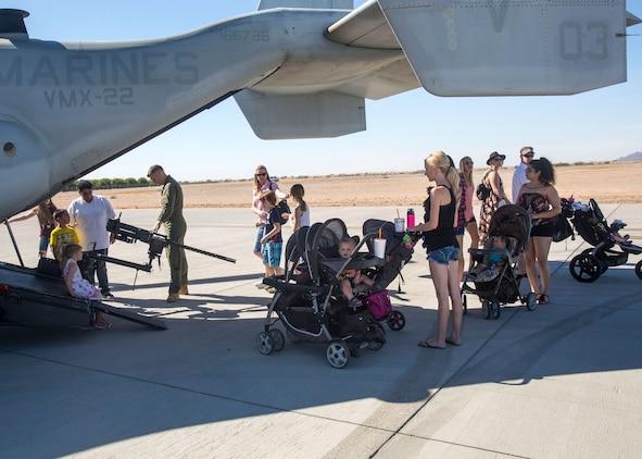 Spectators get an up-close look at military static display aircraft and vehicles during the Yuma Patriot Festival at Marine Corps Air Station Yuma, Ariz., Saturday, Feb. 27, 2016.