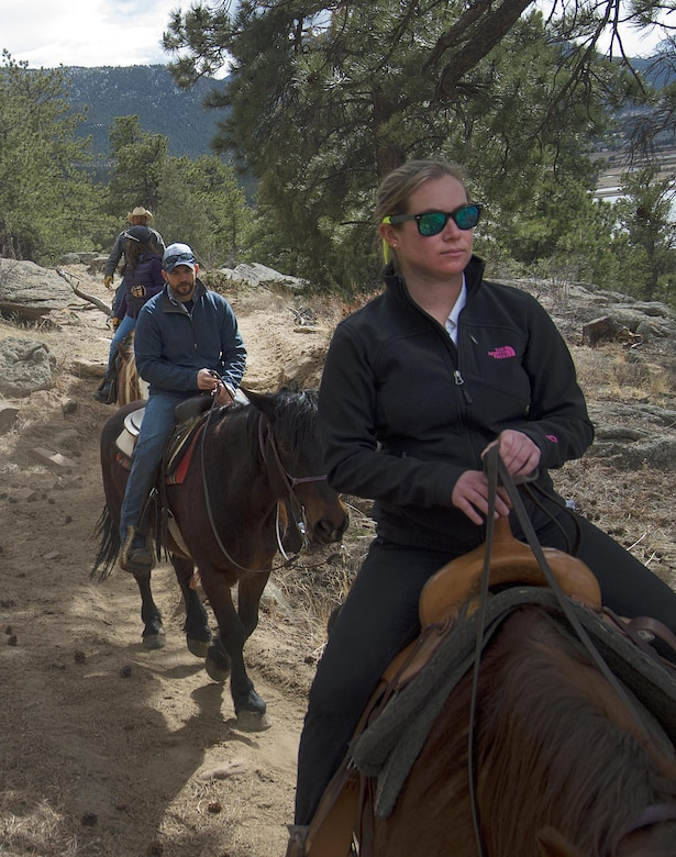 Senior Airman Rachel Silverberg and Joe Harvey, both with the 90th Force Support Squadron, ride near the Arapaho-Roosevelt National Forest above Estes Park, Colo., March 13, 2016. Harvey served as trip leader for an F.E. Warren Air Force Base's Outdoor Recreation trip which brought a group of Airmen, retirees and dependents down from the Wyoming base for the chance to ride. (U.S. Air Force photo by R.J. Oriez)