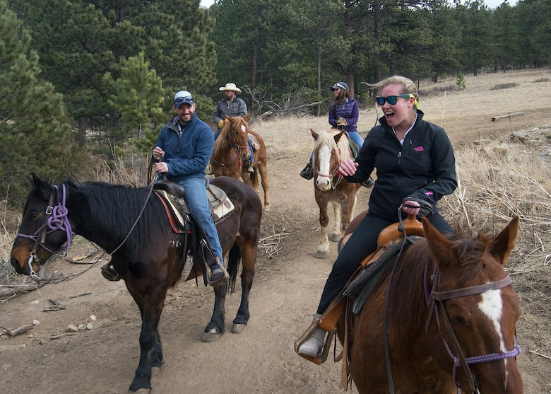 Senior Airman Rachel Silverberg and Joe Harvey, both with the 90th Force Support Squadron, share a laugh during a trail ride outside of Estes Park, Colo., March 13, 2016. Harvey served as trip leader for F.E. Warren Air Force Base Outdoor Recreation-sponsored group of Airmen, retirees and dependents. (U.S. Air Force photo by R.J. Oriez)