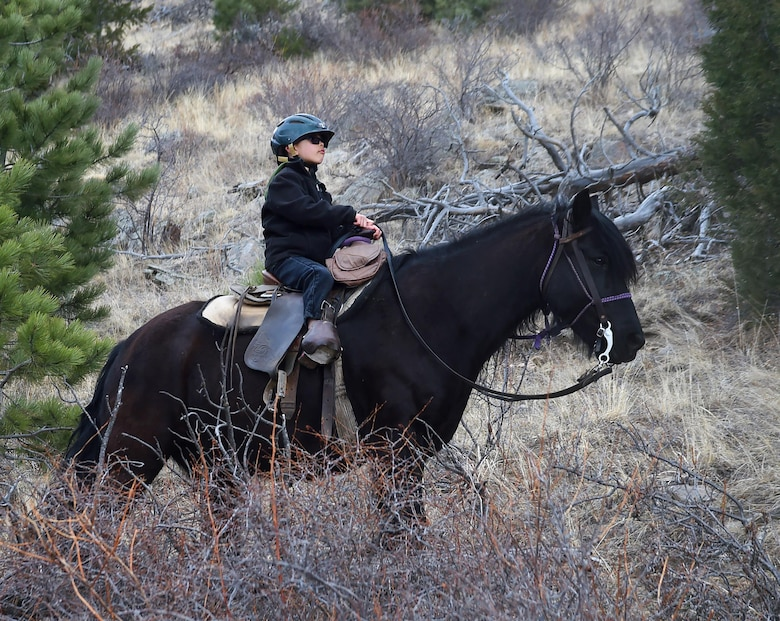 Grayson Orona, 6, takes part in a two-hour trail ride near Estes Parks, Colo., March 13, 2016. Orona and his mother, 2nd Lt. Amanda Transue, 90th Medical Support Squadron, were part of a group brought down by the F.E. Warren Air Force Base Outdoor Recreation Office for the chance to ride. (U.S. Air Force photo by R.J. Oriez)