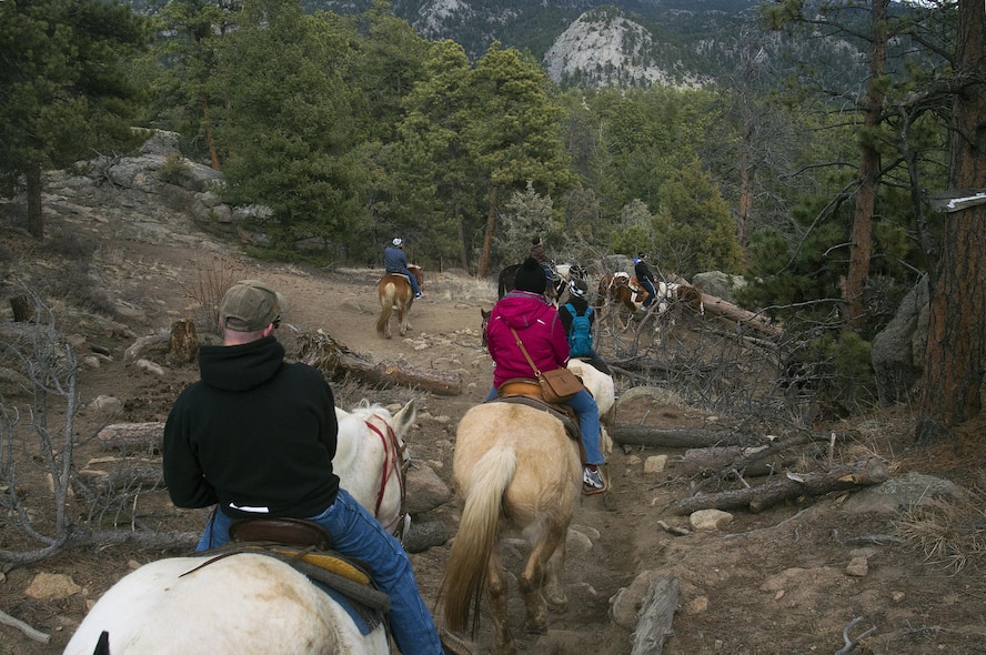 Airmen, retirees and dependents from F.E. Warren Air Force Base, Wyo., ride their mounts down a rocky hillside in the Arapaho-Roosevelt National Forest, Colo., March 13, 2016. The group was part of one of several trips the base's Outdoor Recreation office offers each year. (U.S. Air Force photo by R.J. Oriez)