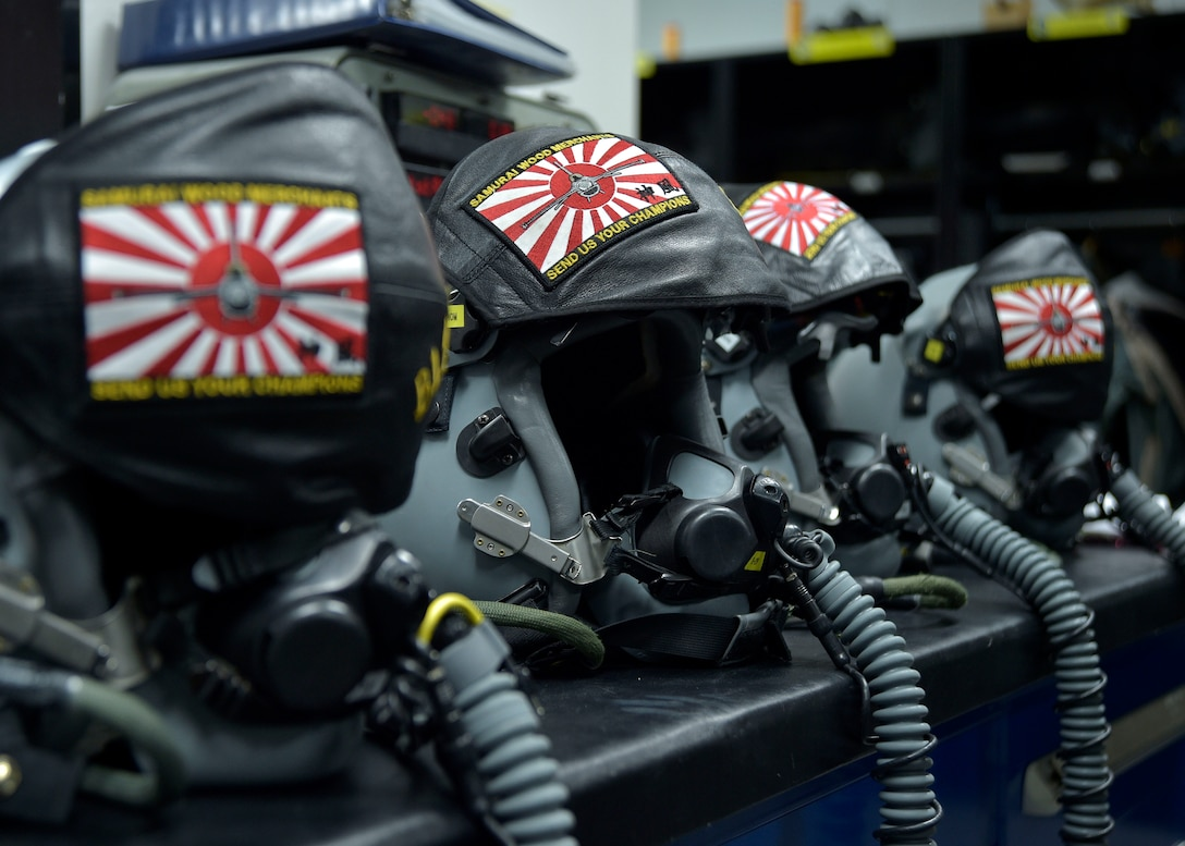 A table full of prepared Joint Helmet Mounted Cueing System helmets and MBU 20/P breathing masks sit in the office of 35th Operations Support Squadron Aircrew Flight Equipment at Misawa Air Base, Japan, March 8, 2016. AFE Airmen conduct pre-checks on all equipment ensuring there are no holes, tears or other discrepancies before the pilots don their gear. The helmet and breathing masks supply oxygen to the pilots while they are flying at high altitudes. (U.S. Air Force photo by Senior Airman Deana Heitzman)