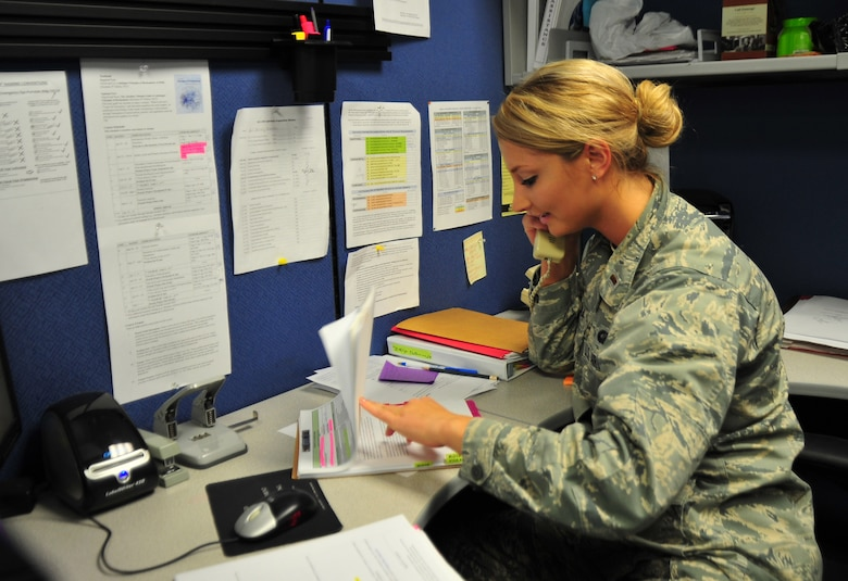 Second Lt. Britney Petrina, 325th Contracting Squadron contract manager, works at her desk March 14 at the 325th CONS. The mission of the squadron is to provide responsive business solutions and acquisition support to Team Tyndall warfighters. (U.S. Air Force photo by Senior Airman Dustin Mullen/Released)